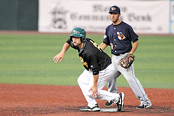 06 July 2013:  Jonathan Johnson tends second base as Mike Schwartz slides in during a Frontier League Baseball game between the Gateway Grizzlies and the Normal CornBelters at Corn Crib Stadium on the campus of Heartland Community College in Normal Illinois