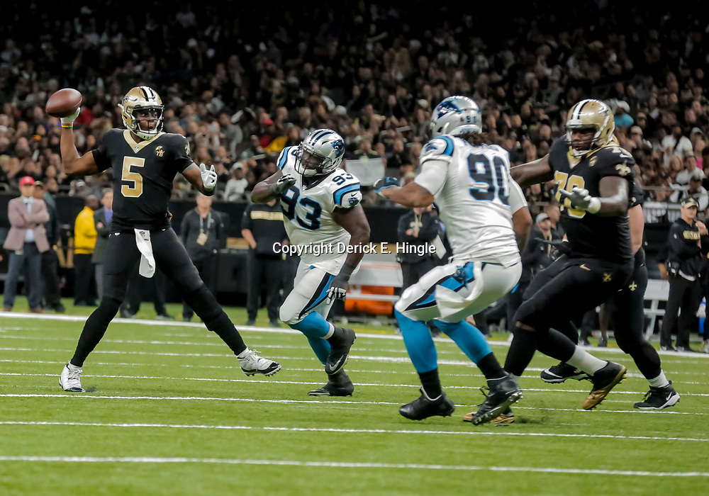 Dec 30, 2018; New Orleans, LA, USA; New Orleans Saints quarterback Teddy Bridgewater (5) throws against the Carolina Panthers during the second half at the Mercedes-Benz Superdome. Mandatory Credit: Derick E. Hingle-USA TODAY Sports