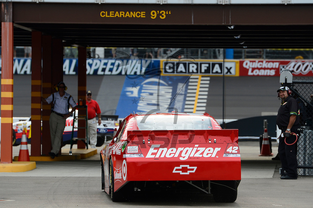 Brooklyn, MI - JUN 16, 2012: Juan Pablo Montoya (42) in the garage during practice for the Quicken Loans 400 race at the Michigan International Speedway in Brooklyn, MI.