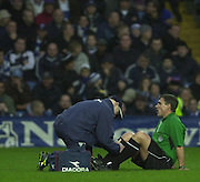 29/11/2003 - Photo  Peter Spurrier.2003/04 Nationwide Football Div 2 QPR V Sheffield Wed.referee recieves attention during the first half.