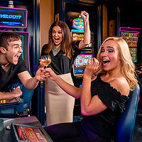 Customers at May's Lounge celebrate their winnings while playing a video slot machine