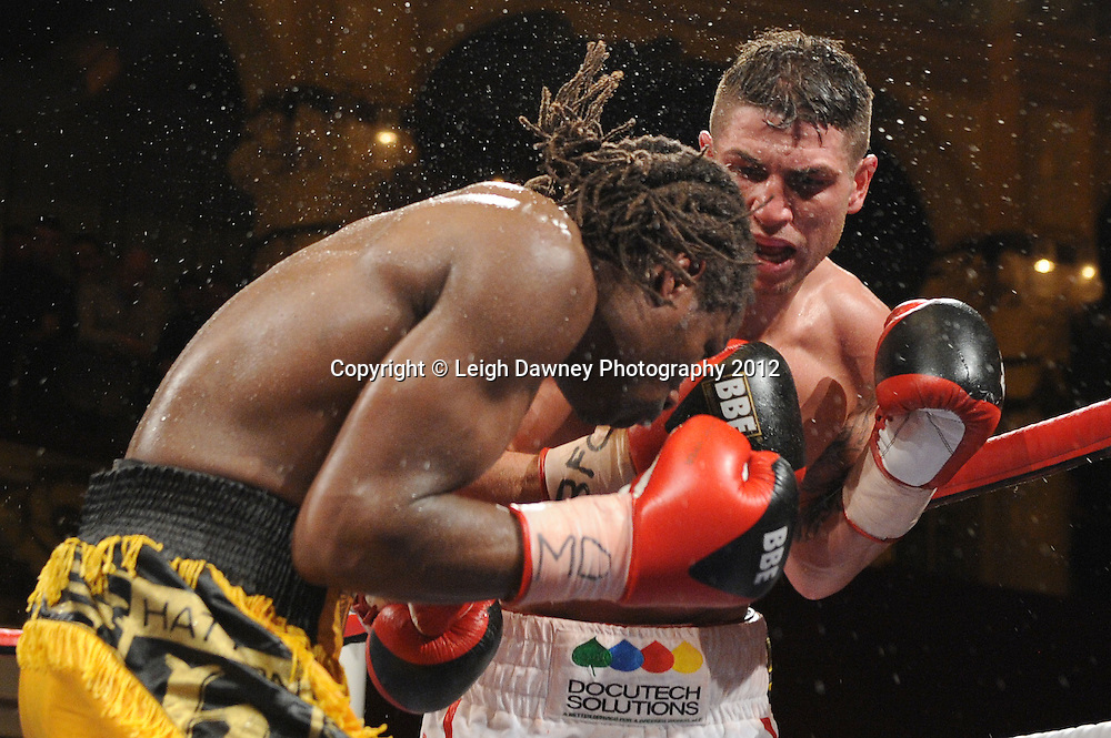 Brian Rose (white shorts) defeats Max Maxwell for the British Light Middleweight Title at the Winter Gardens, Blackpool on the 31st March 2012. Frank Maloney and Steve Wood VIP Promotions. © Leigh Dawney Photography 2012.