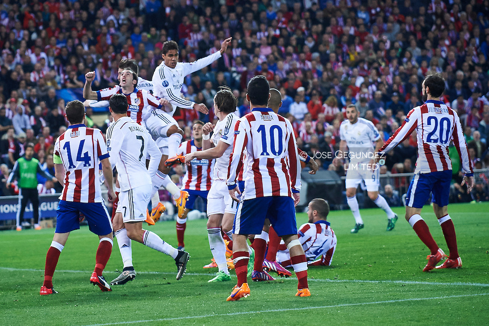 Gabi, Cristiano Ronaldo (Real Madrid F.C.), Raphael Varane (Real Madrid F.C.) and Godin in action during the Champions League, round of 4 match between Atletico de Madrid and Real Madrid at Estadio Vicente Calderon on April 14, 2015 in Madrid, Spain