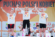 (C) Marzena Karpinska from Poland (48&nbsp;kg category) with the Cup and (L) Ewa Mizdal - second place and (R)  Anna Lesniewska - third place while victory ceremony during Women's Weightlifting Polish Cup 2014 in Jozefow near Warsaw on March 30, 2014.<br /> Marzena Karpinska won the first Women's Weightlifting Polish Cup.<br /> <br /> Poland, Jozefow, March 30, 2014<br /> <br /> Picture also available in RAW (NEF) or TIFF format on special request.<br /> <br /> For editorial use only. Any commercial or promotional use requires permission.<br /> <br /> Mandatory credit:<br /> Photo by &copy; Adam Nurkiewicz / Mediasport