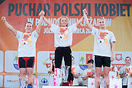 (C) Marzena Karpinska from Poland (48kg category) with the Cup and (L) Ewa Mizdal - second place and (R)  Anna Lesniewska - third place while victory ceremony during Women's Weightlifting Polish Cup 2014 in Jozefow near Warsaw on March 30, 2014.<br /> Marzena Karpinska won the first Women's Weightlifting Polish Cup.<br /> <br /> Poland, Jozefow, March 30, 2014<br /> <br /> Picture also available in RAW (NEF) or TIFF format on special request.<br /> <br /> For editorial use only. Any commercial or promotional use requires permission.<br /> <br /> Mandatory credit:<br /> Photo by © Adam Nurkiewicz / Mediasport