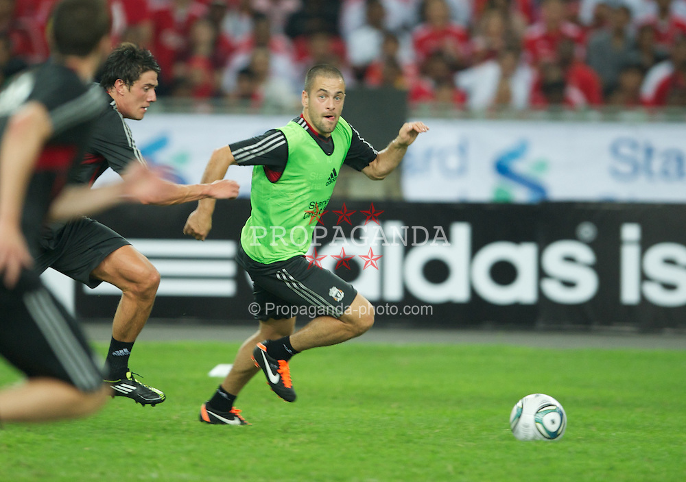 KUALA LUMPUR, MALAYSIA - Thursday, July 14, 2011: Liverpool's Joe Cole during a training session at the National Stadium Bukit Jalil in Kuala Lumpur ahead of their second pre-season friendly match on day four of the club's Asia Tour. (Photo by David Rawcliffe/Propaganda)