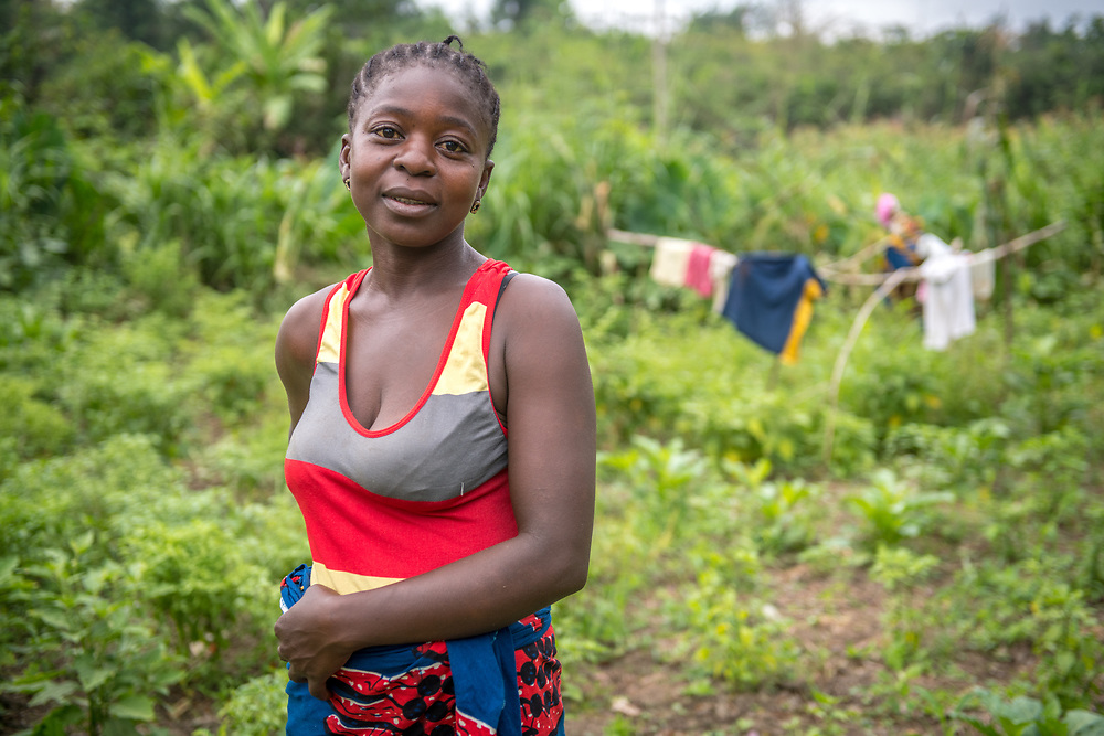 A woman poses on a farm in Ganta, Liberia