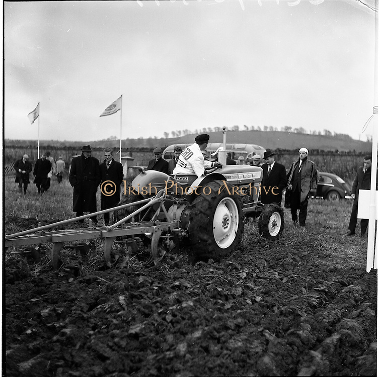 26/11/1964.11/26/1964.26 November 1964.Presentation of new Ford tractors at Lyons Estate Celbridge. The Ford Super Dexta 3000 showing its paces watched by Mr Miceal O'Moran Minister for Lands.