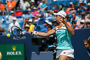 Ashleigh Barty (AUS) hits a backhand to Svetlana Kuznetsova (RUS) during the Western and Southern Open tennis tournament at Lindner Family Tennis Center, Saturday, Aug 17, 2019, in Mason, OH. (Jason Whitman/Image of Sport)
