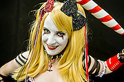 Emily Roberts (cosplayer name Sayuri),27 from Cardif, plays the Harlequin, the Jokers 'girlfriend' from Batman. She puts a lot of effort into developing many versions of the same costume as well as others. She has just taken part in the amateur Cosplay parade which allows people to show off their outfits in front of a large crowd. London Film and Comic Con 2014, (LFCC), at Earls Court, London, UK.