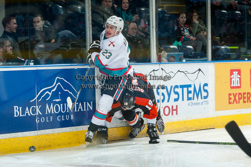 KELOWNA, CANADA - JANUARY 23: David Quenneville #19 of Medicine Hat Tigers checks Justin Kirkland #23 of Kelowna Rockets at the boards on January 23, 2016 at Prospera Place in Kelowna, British Columbia, Canada.  (Photo by Marissa Baecker/Shoot the Breeze)  *** Local Caption *** David Quenneville; Justin Kirkland;