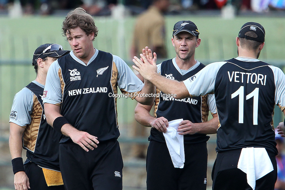 Daniel Vettori congratulates Jacob Oram on the wicket of Kamran Akmal during the ICC World Twenty20 Pool match between Pakistan and New Zealand held at the  Pallekele Stadium in Kandy, Sri Lanka on the 23rd September 2012<br /> <br /> Photo by Ron Gaunt/SPORTZPICS/PHOTOSPORT