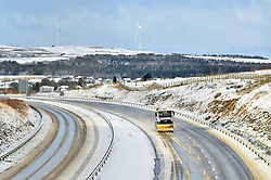 ©Licenced to London News Pictures. 08/12/17. Ebbs Vale, Wales,UK. Snow coming on the back of Storm Caroline, causes traffic disruption in South Wales. Here the A465 Heads of the Valleys Road has just reopened following an earlier accident due to conditions and a gritter plough sent to reopen both lanes and stop further accumulation as further snow showers continue to come in. Photo credit IAN HOMER/LNP