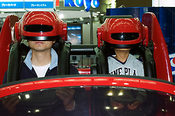 Driving simulator machine using virtual reality at the Tokyo Motor Show 2005
