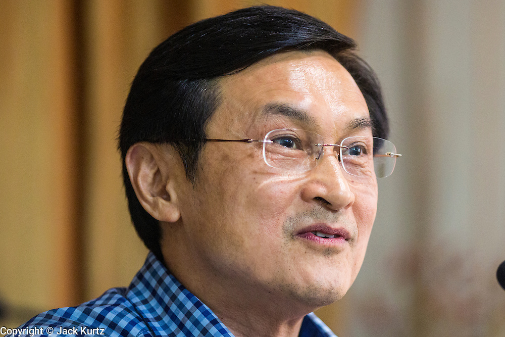 27 MAY 2014 - BANGKOK, THAILAND: CHATURON CHAISANG, a member of the ousted Thai government, during a press conference at the Foreign Correspondents' Club of Thailand. Chaturon, a former Deputy Prime Minister and Education Minister and a senior member of the Pheu Thai Party (the party of the elected civilian government) was arrested by military authorities in Bangkok while he was talking to reporters at the Foreign Correspondents' Club of Thailand. A squad of soldiers came into the packed FCCT dining room, confronted Chaturon and led him to a waiting van.     PHOTO BY JACK KURTZ