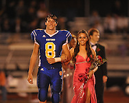 Oxford High's Franklin Tatum (8) escorts senior maid Allison Lyon during Homecoming of the Oxford vs. Hernando in Oxford, Miss. on Friday, October 14, 2011. Hernando won 31-30 in overtime.