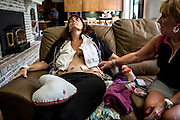 Four days after her mastectomy, Stacey was released from the hospital. On the drive home one of her drains slipped out. Stacey collapsed on the couch, exhausted and in pain while her mom and husband took care of her.