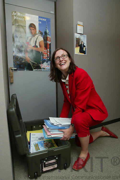 BRUSSELS - BELGIUM - 10 MAY 2006 -- Swedish MEP Cecilia MALMSTRÖM (Malmstroem, Malmstrom) packing her moving box with documents for the next EP-session in Strasbourg. PHOTO: ERIK LUNTANG /