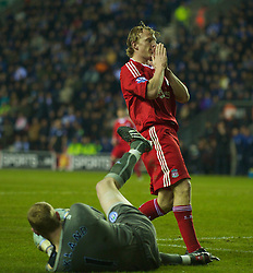 WIGAN, ENGLAND - Monday, March 8, 2010: Liverpool's Dirk Kuyt rues a missed chance during his side's embarrassing defeat to Wigan Athletic during the Premiership match at the DW Stadium. (Photo by David Rawcliffe/Propaganda)