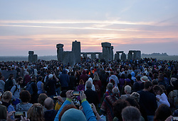 © Licensed to London News Pictures.21/06/2017. Stonehenge, Amesbury, Wiltshire, UK. Summer Solstice celebrations at Stonehenge. Shortly after sunrise on the longest day of the year. Photo credit : Simon Chapman/LNP