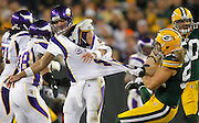 Green Bay Packers' Clay Matthews tugs on the shirt of Minnesota Vikings' quarterback Brett Favre at Lambeau Field Oct, 24, 2010. Jeffrey Phelps/AP