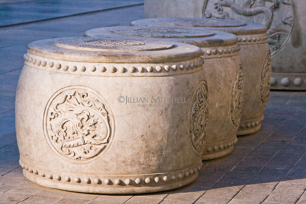 Stone stools in the shape of traditonal chinese drums on the restored Qianmen street.