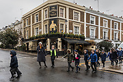 London, England, UK, February 4 2018 - Elephant & Castle pub and school pupils in the Kensington area.