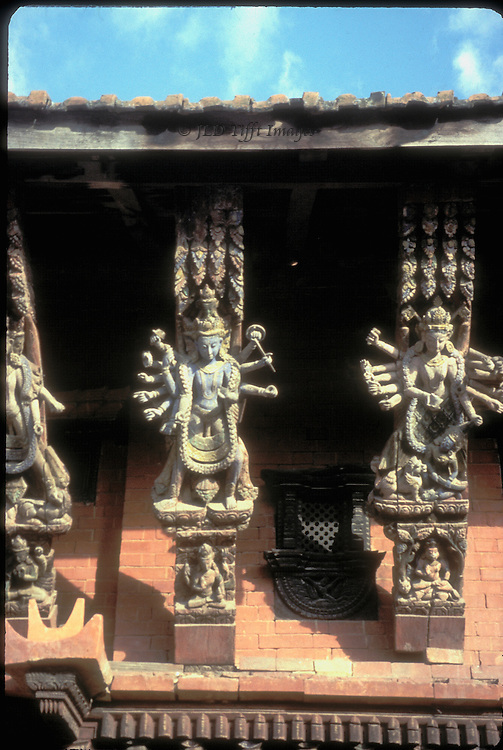 Detail of carved wooden roof struts, each with a multi-armed Hindu deity and small erotic panels. Nerwari style sculpture.
