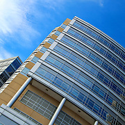 """""""Reflecting Angles""""<br /> <br /> A beautiful angled image in wonderful blue tones of an area of the C.S. Mott Children's Hospital in Ann Arbor Michigan!!<br /> <br /> Architecture: Structures, buildings and their details by Rachel Cohen"""