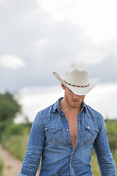 cowboy with his head lowered walking