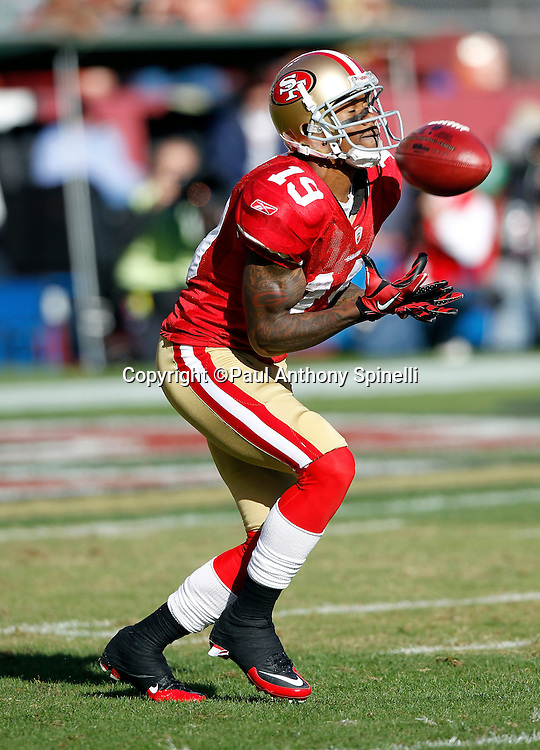 San Francisco 49ers kickoff returner Ted Ginn Jr. (19) closes his eyes as he catches a kick during the NFL week 11 football game against the Tampa Bay Buccaneers on Sunday, November 21, 2010 in San Francisco, California. The Bucs won the game 21-0. (©Paul Anthony Spinelli)