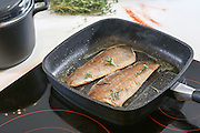 Frying fish on an electric stove