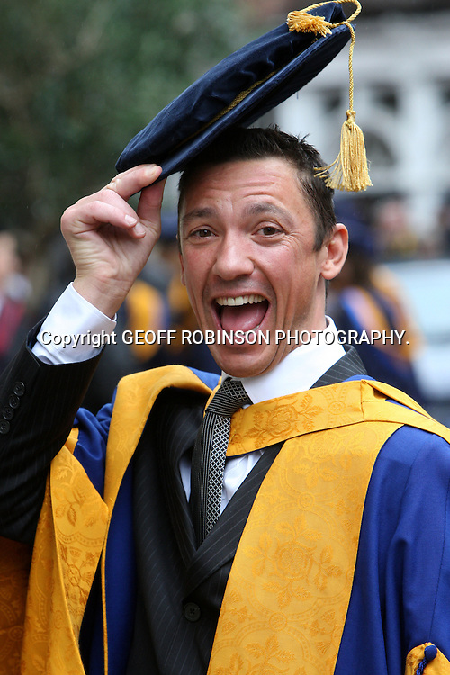 "PIC SHOWS JOCKEY FRANKIE DETTORI IN CAMBRIDGE  ON THURSDAY MORNING 13 OCT WHERE HE RECEIVED AN HONORARY DEGREE... Pint-size jockey Frankie Dettori joked about whether the university would find a gown to fit him as he received an honorary degree in Cambridge today (Thurs)...The Italian-born multimillionaire, who is just 5ft 4, said he was ""shocked and surprised"" to be made a Doctor of Science by Anglia Ruskin University for his services to horse racing...Frankie, 41, was joined by his wife Catherine for the special degree ceremony at the Cambridge Corn Exchange...""I was really hoping they would have a gown in my size,"" he said, proudly wearing the traditional floppy hat and gown...""I was very shocked and surprised when I received the letter about getting an honorary degree a couple of months ago...""I was quite taken aback even though I have now been in this country for 25 years. I'm very excited and it's a real honour."".SEE COPY CATCHLINE Frankie Dettori honorary degree"