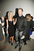 Donna Air and Patrick Cox, Work by Mexican artist, Gabriel Orozco. Gallery opening & private view at new White Cube space, 25-26 Mason's Yard, London and afterwards at Claridges. London. 27 September 2006. <br /> -DO NOT ARCHIVE-© Copyright Photograph by Dafydd Jones 66 Stockwell Park Rd. London SW9 0DA Tel 020 7733 0108 www.dafjones.com