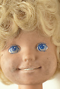 close-up face of smudged doll head