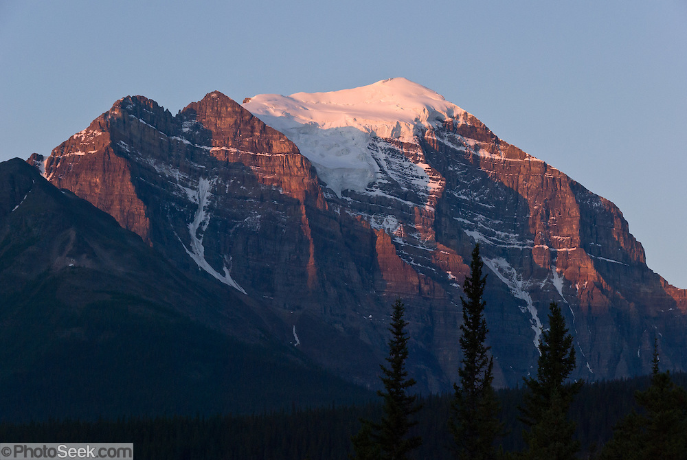 See Mount Temple (3543 metres  or 11,624 feet) from town of Lake Louise in Banff National Park, Alberta, Canada. This is part of the big Canadian Rocky Mountain Parks World Heritage Site declared by UNESCO in 1984.