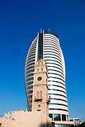 Israel, Haifa, Downtown, The Sail Tower modern high-rise building behind a historical building
