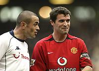Photo. Aidan Ellis.<br />Manchester United v Tottenham Hotspur.<br />FA Barclaycard Premiership.<br />20/03/2004.<br />United's Roy Keane enjoys a joke with Spurs Steven Carr