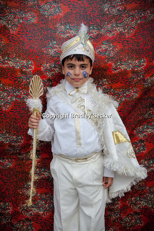 Gencay after his traditional circumcision in Sariyer, a town on the Bosphorus coastline north of Istanbul. The boys dress in costumes of Ottoman sultans on the day when they are seen as stepping into manhood.