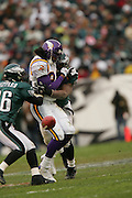 16 Jan 2005:Randy Moss of the Minnesota Vikings in hit by #54 Jeremiah Trotter of the Philadelphia Eagles during the Philadelphia Eagles 27-14 victory over the Minnesota Vikings at Lincoln Financial Field in Philadelphia, PA. <br />