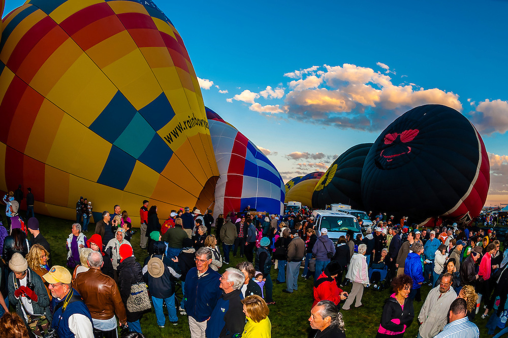 Hot air balloons being inflated are surrounded by spectators, Balloon Fiesta Park, Albuquerque International Balloon Fiesta, Albuquerque, New Mexico USA.