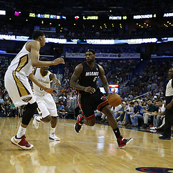 Mar 22, 2014; New Orleans, LA, USA; Miami Heat forward LeBron James (6) drives past New Orleans Pelicans forward Anthony Davis (23) and forward Al-Farouq Aminu (0) during the second half of a game at the Smoothie King Center. The Pelicans defeated the Heat 105-95. Mandatory Credit: Derick E. Hingle-USA TODAY Sports