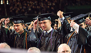 OHIO Graduates reposition the tassels on their caps at spring undergraduate commencement. Photo by Ben Siegel