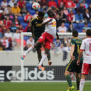 Rauwshan McKenzie, Portland Timbers, wins a header against Bradley Wright-Phillips, New York Red Bulls  during the New York Red Bulls Vs Portland Timbers, Major League Soccer regular season match at Red Bull Arena, Harrison, New Jersey. USA. 24th May 2014. Photo Tim Clayton
