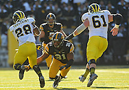 November 23 2013: Iowa Hawkeyes linebacker Anthony Hitchens (31) tries to dive for Michigan Wolverines running back Fitzgerald Toussaint (28) during the second quarter of the NCAA football game between the Michigan Wolverines and the Iowa Hawkeyes at Kinnick Stadium in Iowa City, Iowa on November 23, 2013. Iowa defeated Michigan 24-21.