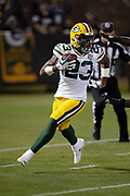 Green Bay Packers rookie cornerback Jaire Alexander (23) runs with the ball after intercepting a second quarter pass that gives the Packers the ball at their own 7 yard line and stopping a deep Raiders drive during the 2018 NFL preseason week 3 football game against the Oakland Raiders on Friday, Aug. 24, 2018 in Oakland, Calif. The Raiders won the game 13-6. (©Paul Anthony Spinelli)