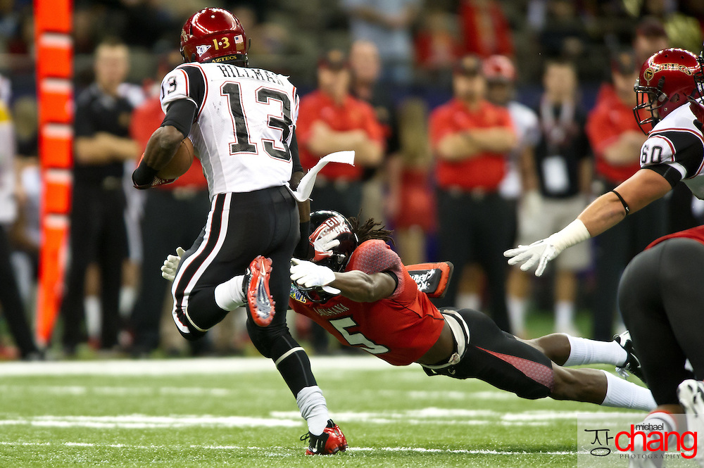 """Louisiana-Lafayette's Dwight """"Bill"""" Bentley CB (5) leaps to tackle San Diego State's RB Ronnie Hillman (13) during the R+L Carriers New Orleans Bowl at the Mercedes-Benz Superdome.  Louisiana-Lafayette defeated San-Diego State 32-30. (Copyright Michael Chang)"""