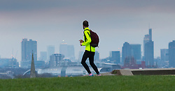 Primrose Hill, London, February 15th 2015. A runner admires the view of London's skyline on a chilly early morning on Primrose Hill, overlooking London&rsquo;s skyline.<br /> ///FOR LICENCING CONTACT: paul@pauldaveycreative.co.uk TEL:+44 (0) 7966 016 296 or +44 (0) 20 8969 6875. &copy;2015 Paul R Davey. All rights reserved.