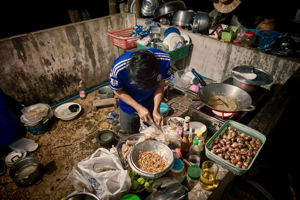 Locals prepare dinner on New Years Eve, in Nakhon Nayok, Thailand