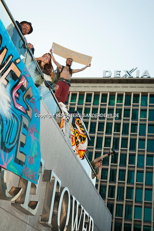 Indignados protests against the financial crisis and the power of banks and kapitalism. At the Finance Tower with Dexia in the background. Brussels Belgium 15 october 2011